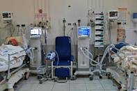 Patients with coronavirus patients lie intubated in an intensive care unit in Tunisia's coastal city of Sousse