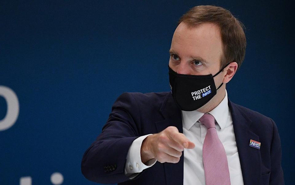 Britain's Health Secretary Matt Hancock wearing a face mask during a visit with Britain's Camilla, Duchess of Cornwall (unseen) to watch a demonstration by the charity Medical Detection Dogs. - Justin Tallis/WPA Pool/Getty Images