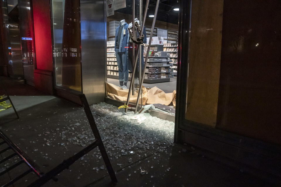 A looted Muji store with broken windows in Manhattan on June 1, 2020. (Lev Radin / Sipa USA via AP file)
