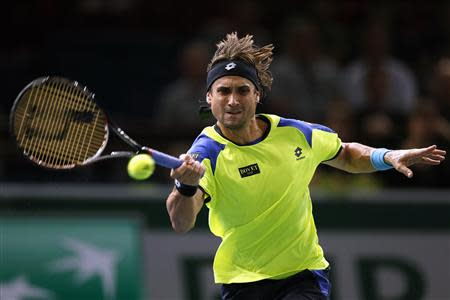 David Ferrer of Spain returns a shot to Gilles Simon of France at the Paris Masters men's singles tennis tournament at the Palais Omnisports of Bercy in Paris, October 31, 2013. REUTERS/Charles Platiau