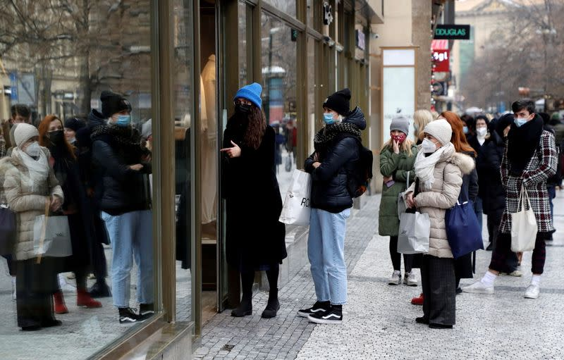 FILE PHOTO: Customers at re-opened shops as restrictions ease in Prague