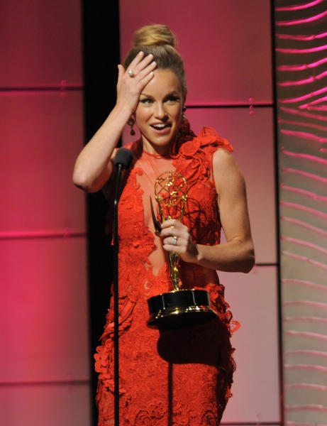 "Julie Marie Berman accepts the award for outstanding supporting actress in a drama series for ""General Hospital"" at the 40th Annual Daytime Emmy Awards on Sunday, June 16, 2013, in Beverly Hills, Calif. (Photo by Chris Pizzello/Invision/AP)"