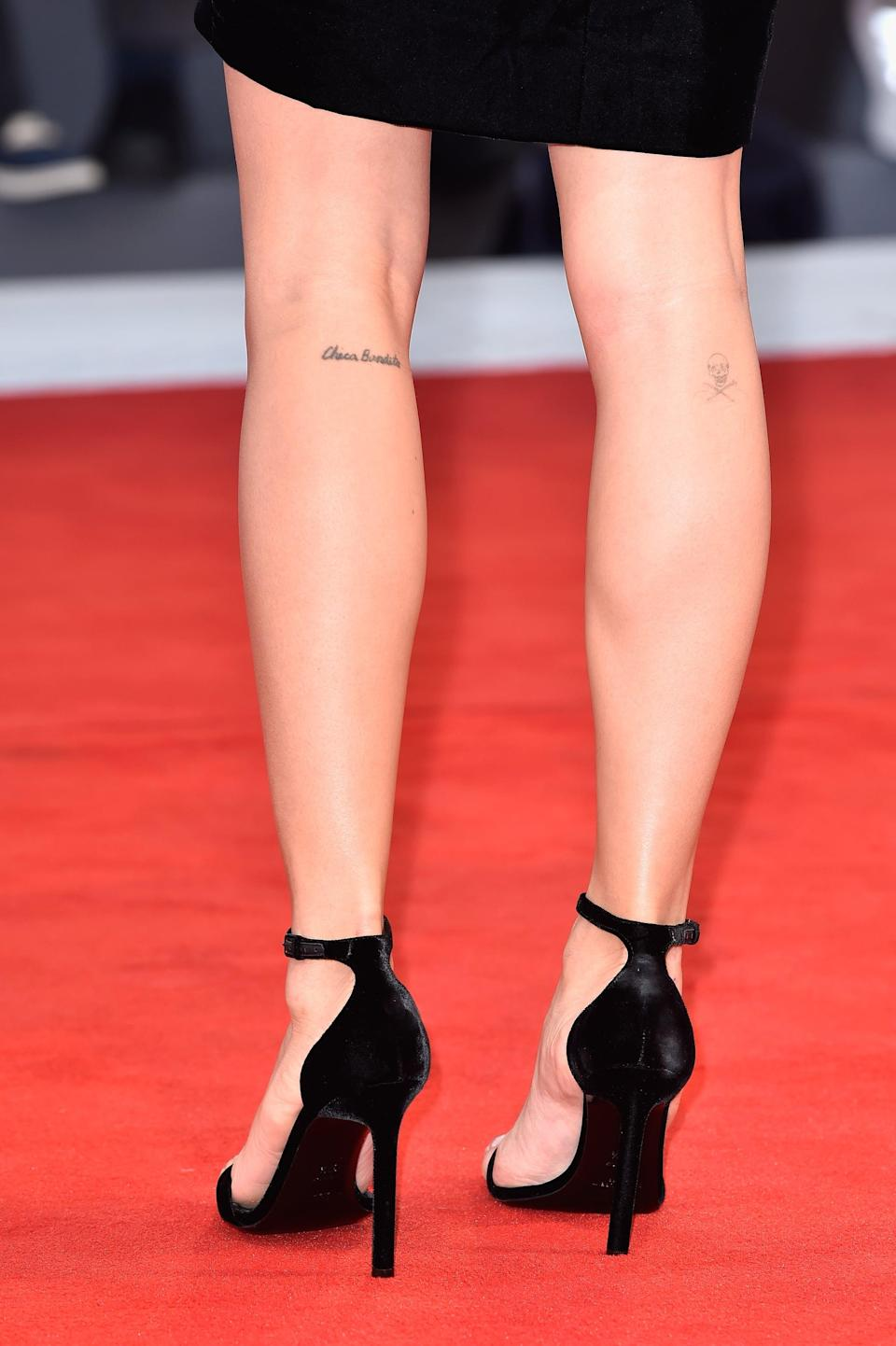 """<p>Kravitz has the phrase """"Chica Bandito"""" on her left calf, which is a Spanish phrase for """"Beautiful girl,"""" and a skull and crossbones on her right.</p>"""