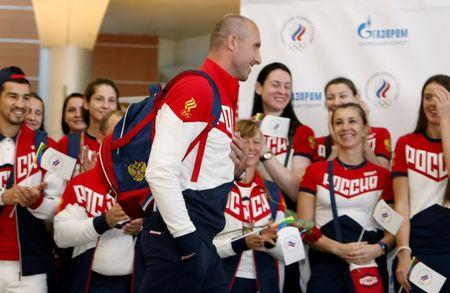 Russia men's volleyball Olympic team member Tetyukhin walks during farewell ceremony before national team's departure to 2016 Rio Olympics at Sheremetyevo Airport outside Moscow