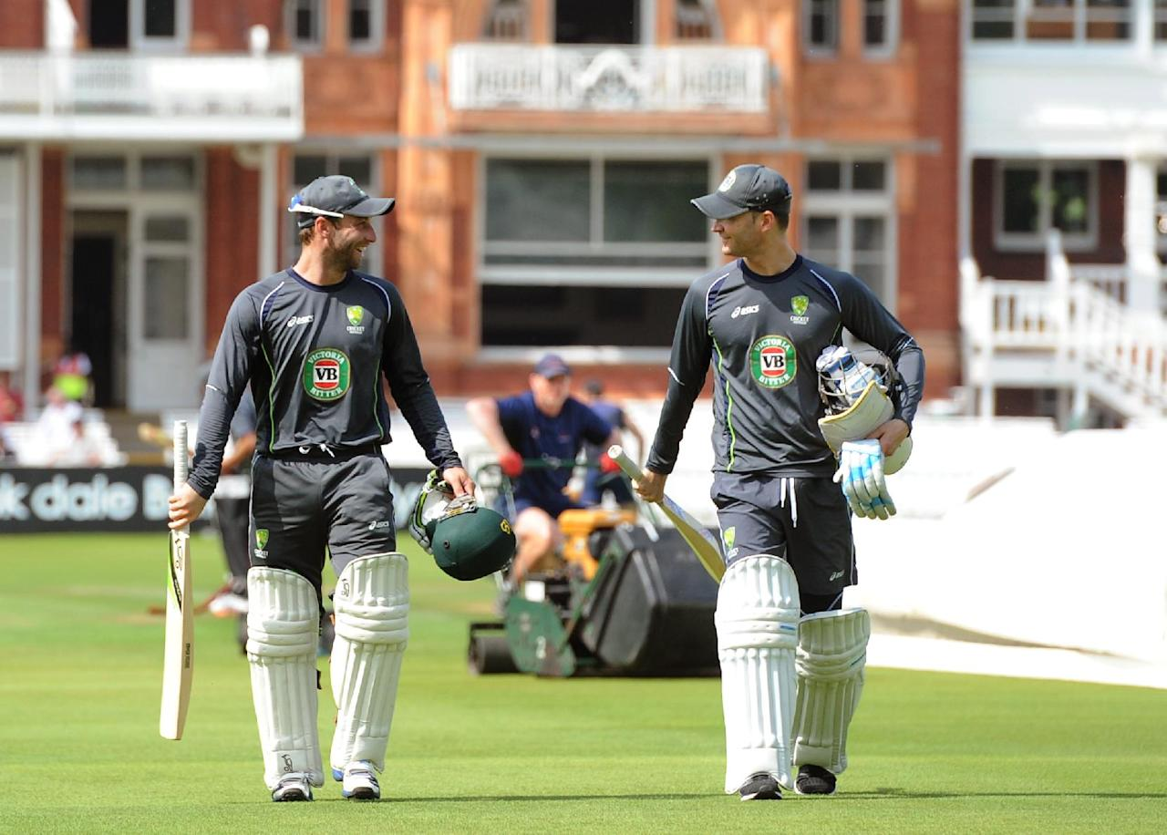 Australia's Philip Hughes (left) and Michael Clarke arrive for the nets session at Lord's Cricket Ground, London.