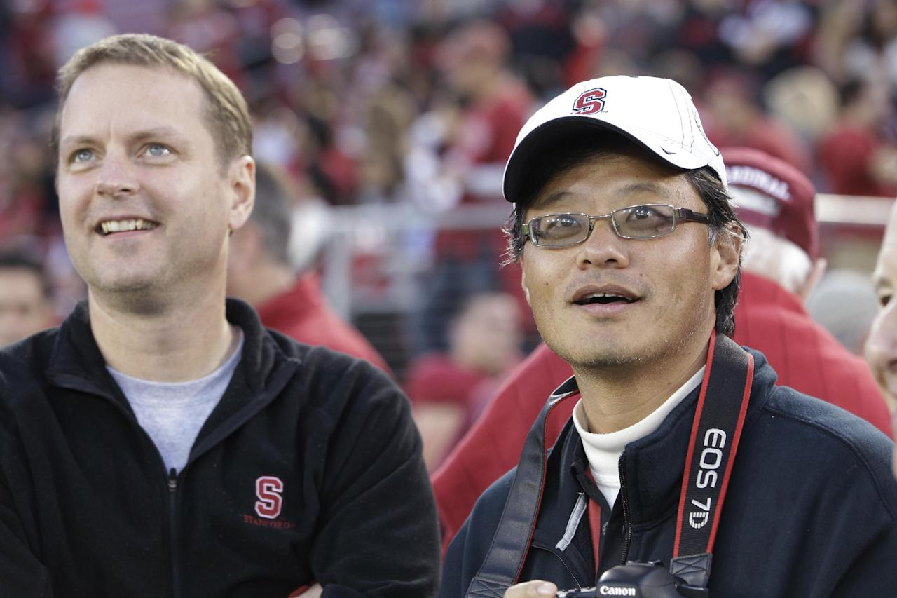 FILE - In this Nov. 26, 2011 photo, Yahoo co-founders Jerry Yang, right, and David Filo, left, at an NCAA college football game in Palo Alto, Calif. Yang is leaving the struggling company. The surprise departure, announced Tuesday, Jan. 17, 2012 comes just two weeks after Yahoo Inc. hired former PayPal executive Scott Thomson as its CEO. (AP Photo/Paul Sakuma)