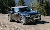 """<p>The biggest Mini sold today received a bunch of updates for 2021. The <a href=""""https://www.caranddriver.com/mini/cooper-countryman-s"""" rel=""""nofollow noopener"""" target=""""_blank"""" data-ylk=""""slk:Countryman"""" class=""""link rapid-noclick-resp"""">Countryman</a>'s improvements include a restyled front bumper with LED headlights, new wheels, and additional leather trim. Plus, every Countryman now has taillights with the Union Jack design. A 134-hp turbocharged three-cylinder and seven-speed dual-clutch automatic are standard, but all-wheel-drive models come with an eight-speed automatic instead. The Countryman S gets a turbocharged four-cylinder with 55 extra horsepower, but the <a href=""""https://www.caranddriver.com/news/a30534124/mini-countryman-jcw-acceleration/"""" rel=""""nofollow noopener"""" target=""""_blank"""" data-ylk=""""slk:quickest Mini we've ever tested"""" class=""""link rapid-noclick-resp"""">quickest Mini we've ever tested</a> is the 301-hp <a href=""""https://www.caranddriver.com/mini/cooper-countryman-jcw"""" rel=""""nofollow noopener"""" target=""""_blank"""" data-ylk=""""slk:Countryman John Cooper Works"""" class=""""link rapid-noclick-resp"""">Countryman John Cooper Works</a> All4 with a 4.4-second sprint to 60 mph. There's even a plug-in hybrid Countryman SE with an EPA-estimated 73 MPGe. Interestingly, the Countryman at the bottom of this segment shares the same platform with the <a href=""""https://www.caranddriver.com/bmw/x1"""" rel=""""nofollow noopener"""" target=""""_blank"""" data-ylk=""""slk:BMW X1"""" class=""""link rapid-noclick-resp"""">BMW X1</a> at the top, but the Mini has poor ride quality and its most fun version might be a little too rich for most.</p><ul><li>Base price: $27,350 (Countryman) $42,350 (JCW)</li><li>EPA Fuel Economy combined/city/highway: 29/26/33 mpg (FWD)</li><li>Rear cargo space: 15 cubic feet</li></ul><p><a class=""""link rapid-noclick-resp"""" href=""""https://www.caranddriver.com/mini/cooper-countryman-s/specs"""" rel=""""nofollow noopener"""" target=""""_blank"""" data-ylk=""""slk:MORE COUNTRYMAN SPECS"""">MORE COUNTRYMAN SPECS</a></p"""