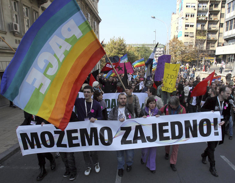 "This Oct. 10, 2010 file photo shows members of the Serbian gay community marching down a street in Belgrade, Serbia. ""The Parade,"" a black comedy made by a Serbian director, has been the biggest box office hit in the former Yugoslavia in years, even as it challenges both the region's ethnic divide and its deeply rooted homophobia. The movie has drawn more than half a million people since its release in October. It has been equally acclaimed in Serbia, Croatia and Bosnia _ something no local film has managed since the 1990s wars between the ex-Yugoslav republics. (AP Photo/Darko Vojinovic)"