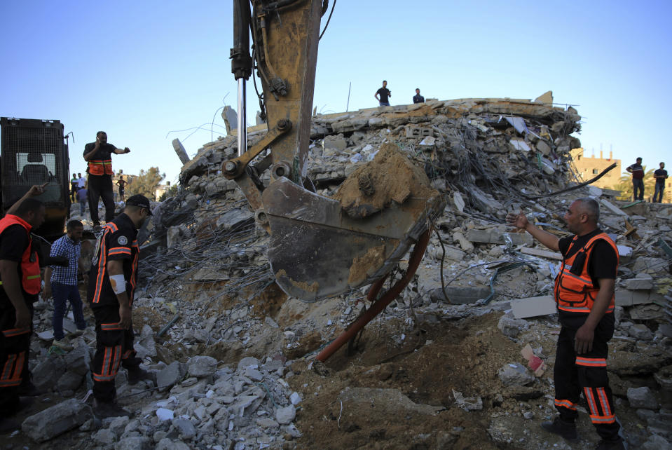 Palestinians rescuers search in the rubble for missing members of the Al-Tanani family, after their house was destroyed by Israeli airstrikes in town of Beit Lahiya, northern Gaza Strip, Thursday, May 13, 2021. (AP Photo/Abdel Kareem Hana)