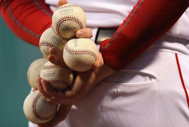 Okay, that guy can hold a lot of baseballs in his hands. (Getty Images)