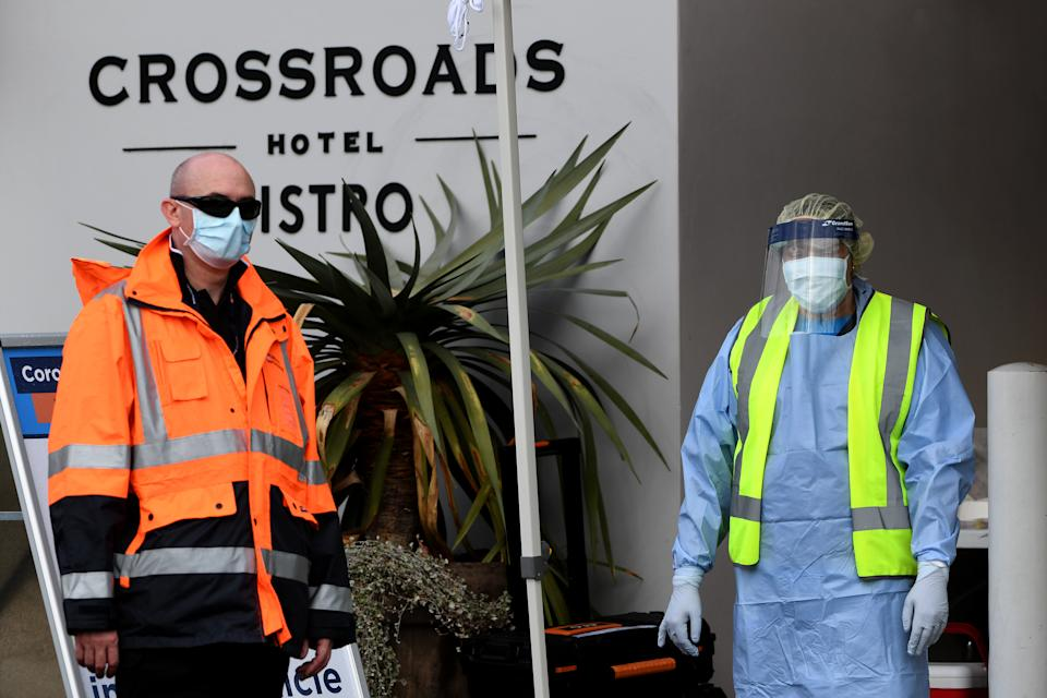 NSW Health workers and security at Crossroads Hotel in Sydney.
