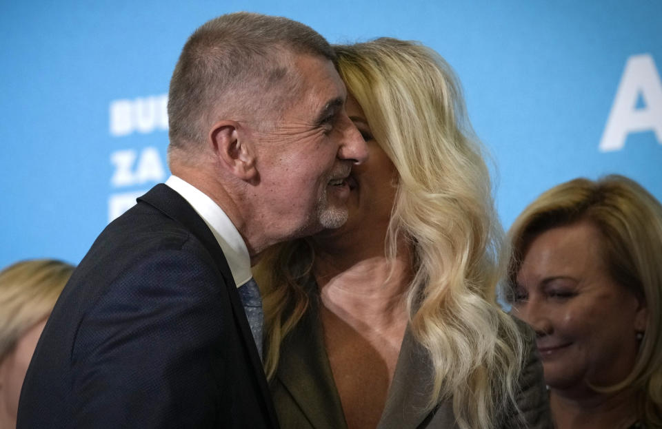 Czech Republic's Prime Minister and leader of centrist ANO (YES) movement Andrej Babis is kissed by his wife Monika, Prague, Czech Republic, Saturday, Oct. 9, 2021. Prime Minister Andrej Babis's centrist party has narrowly lost the Czech Republic's parliamentary election, a surprise development that could mean the end of the populist billionaire's reign in power. With the votes from 99.7% of the ballot stations counted, the Czech Statistics Office said Together, a liberal-conservative three-party coalition, captured 27.7% of the vote, beating Babis's ANO (Yes) party, which won 27.2%. (AP Photo/Petr David Josek)