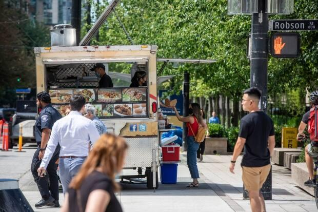 A food truck on Howe Street near the 800 Robson Plaza in downtown Vancouver, on June 22. Food trucks have not been allowed to return to the plaza since it reopened in March. (Ben Nelms/CBC - image credit)