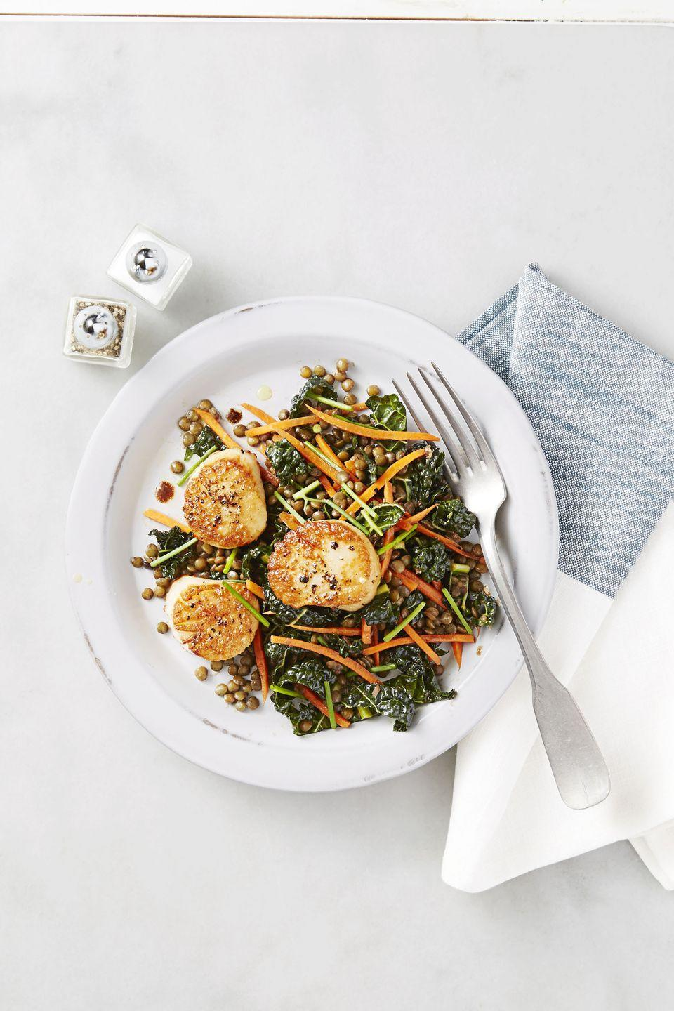 """<p>On Wednesdays, treat yourself for making it halfway through the week with this fancy feast. Bonus points for pouring yourself a glass of Chardonnay —you deserve it!</p><p><em><a href=""""https://www.goodhousekeeping.com/food-recipes/a38406/seared-scallops-with-lentil-salad-recipe/"""" rel=""""nofollow noopener"""" target=""""_blank"""" data-ylk=""""slk:Get the recipe for Seared Scallops with Lentil Salad »"""" class=""""link rapid-noclick-resp"""">Get the recipe for Seared Scallops with Lentil Salad »</a></em></p>"""