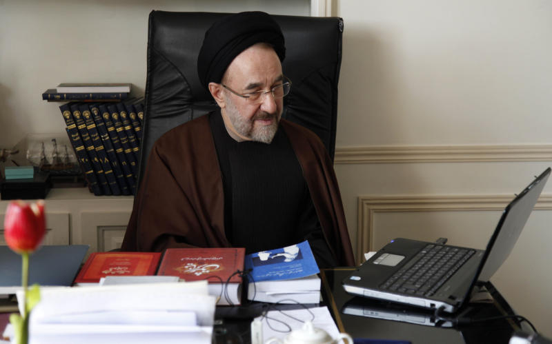 In this undated photo released by office of former Iranian President Mohammad Khatami, Mohammad Khatami, watches a video on his laptop, at his office, in Tehran, Iran. Many reformists are expected to sit out the June 14 voting in a silent protest over the crackdowns that have left them leaderless and demoralized. Others unwilling to boycott the election are rallying around a last-ditch call for help to Khatami, who is seen increasingly as their only credible hope at the ballot box. (AP Photo/Office of Mohammad Khatami, Asghar Khaksar)