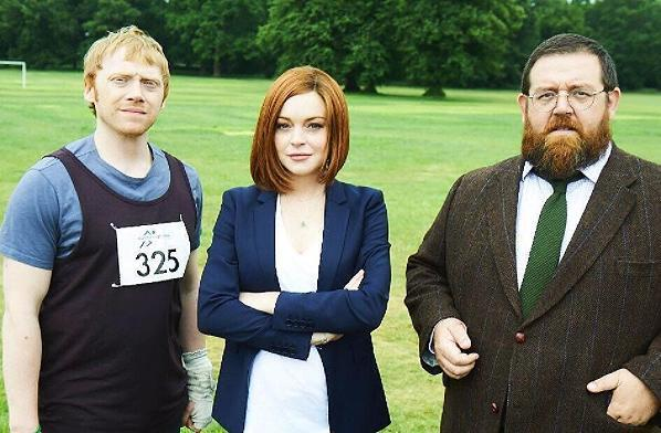 """<p><b>When: June 12, 2017</b><br>Lindsay Lohan debuted a more sophisticated look as she posed alongside castmates Rupert Grint and Nick Frost on set of her new British TV series, """"Sick Note."""" In a recent photo posted to Instagram, the sultry redhead looked the very image of perfection in a smart blue blazer and white v-neck shirt — but it was her fierce red locks that stole the snap. Lohan chopped her long, wavy red tresses into a short, asymmetric bob! It's Lohan's first acting role in two years and the new 'do gives the 30-year-old a fresh, youthful appearance, don't you think? <i> (Photo: Instagram) </i> </p>"""