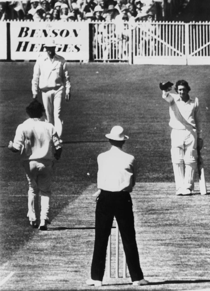 Derek Randall of the M.C.C. doffs his cap to Australian bowler Dennis Lillie after ducking an awkward ball during the centenary test match against Australia in Melbourne, 14th March 1977. (Photo by Central Press/Hulton Archive/Getty Images)