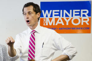 In this July 29, 2013, photo New York City mayoral candidate Anthony Weiner talks to voters in the Queens borough of New York. Weiner's campaign manager resigned after revelations emerged that Weiner continued to exchange sexually explicit online messages with women after he resigned from Congress in 2011 because of a sexting scandal. And in New York longtime Hillary Clinton aide Huma Abedin's decision to stick by Weiner, her husband, has drawn comparisons by Republicans to Clinton's support of her husband during reports of his infidelities, his impeachment by the House and subsequent acquittal by the Senate over his relationship with Monica Lewinsky. (AP Photo/John Minchillo, File)