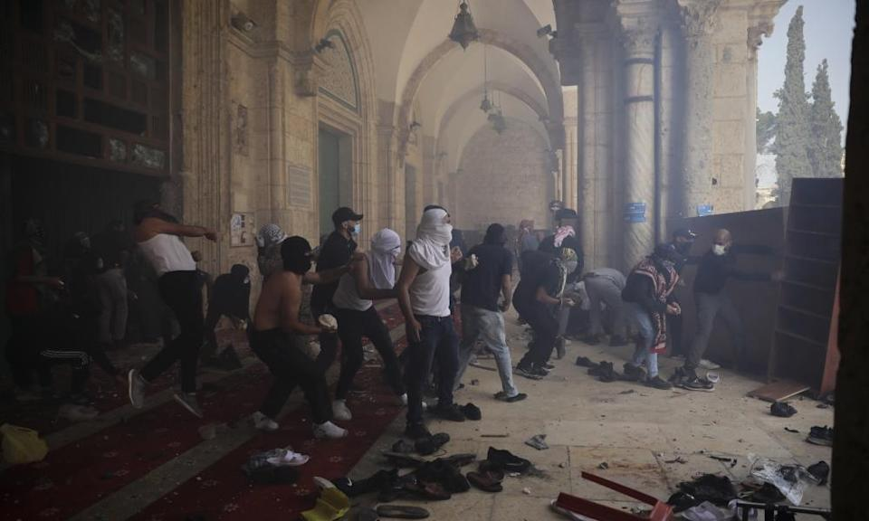 Palestinians clash with Israeli security forces at the Al Aqsa Mosque compound in Jerusalem's Old City on May 10.