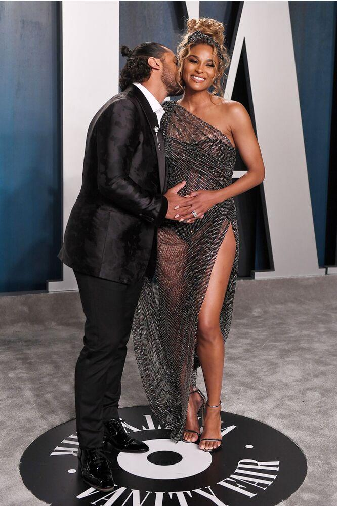 Ciara (R) and Russell Wilson | Anthony Harvey/Shutterstock