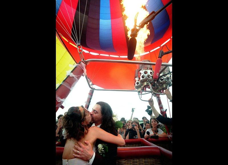 Full of Hot Air: This bride and groom were full of hot air on their big day in Berlin. Christof Galuschka, right, and Evelyn Neew locked lips on July 22, 1998, aboard a hot-air balloon that was set to take off during their vows. Unfortunately, just two days before the wedding, authorization for their sky-high nuptials was yanked, bursting the bubble on what would've been Germany's first-ever hot-air balloon wedding. The couple went ahead with the prop, knowing their ceremony wouldn't be valid, and vowed to make their union official later.