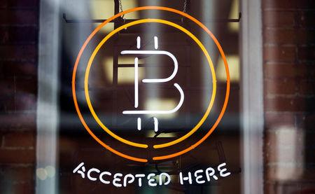 FILE PHOTO - A Bitcoin sign is seen in a window in Toronto