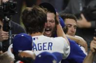 Los Angeles Dodgers pitcher Clayton Kershaw celebrates they defeat the Tampa Bay Rays 3-1 to win the baseball World Series in Game 6 Tuesday, Oct. 27, 2020, in Arlington, Texas. (AP Photo/Tony Gutierrez)