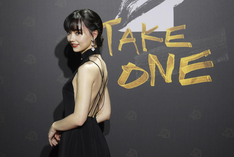 "Australian-born Taiwanese professional Go player Joanne Missingham arrives at the 57th Golden Horse Awards in Taipei, Taiwan, Saturday, Nov. 21, 2020. Liu is nominated for Best Leading Actor for the film ""My Missing Valentine"" at this year's Golden Horse Awards, one of the Chinese-language film industry's biggest annual events. (AP Photo/ Billy Dai)"