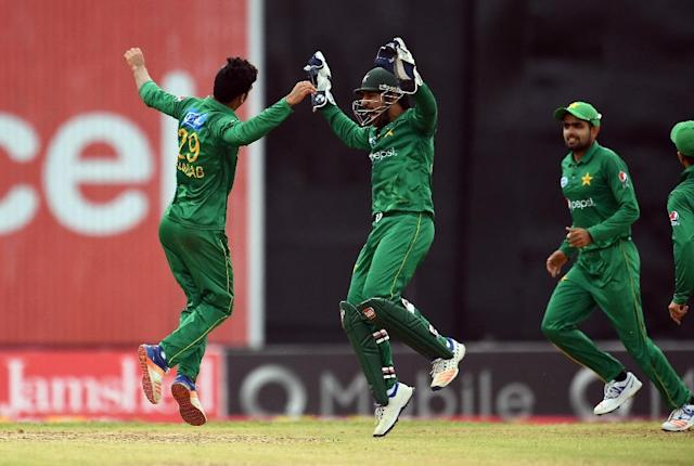 Pakistan's Shadab Khan (#29) celebrates with team captain/wicketkeeper Sarfraz Ahmed after bowling out West Indies' Rovman Powell (R) during the second of four-T20I-match between West Indies and Pakistan on March 30, 2017 (AFP Photo/Jewel SAMAD)