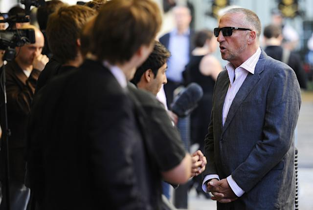 "Former cricket player Sir Ian Botham OBE (R) talks to the media as he arrives for the world premiere of cricket film ""From the Ashes"", in London on May 10, 2011. AFP PHOTO/Carl de Souza (Photo credit should read CARL DE SOUZA/AFP/Getty Images)"