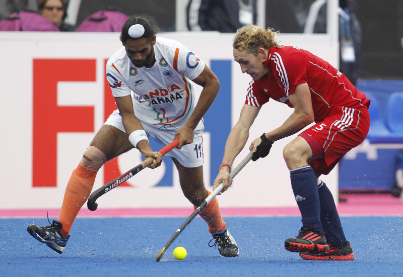 Britain's Richard Alexander, right, competes with India's Sarvanjit Singh during the men's bronze medal field hockey match between Britain and India at the Riverbank field hockey arena in the Olympic Park in London, Sunday, May 6, 2012. (AP Photo/Sang Tan)