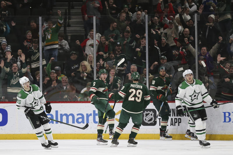 Minnesota Wild's Ryan Donato (6) looks to teammate Greg Pateryn (29) in celebration after Donato scored a goal in the second period of an NHL hockey game against the Dallas Stars, Saturday, Jan. 18, 2020, in St. Paul, Minn. (AP Photo/Stacy Bengs)