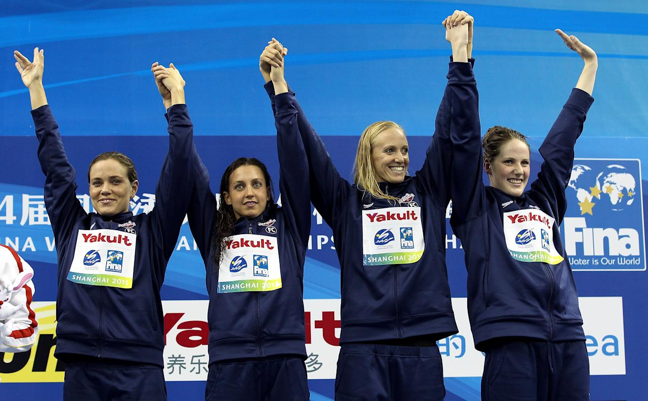 SHANGHAI, CHINA - JULY 30:  (L-R) Natalie Coughlin, Rebecca Soni, Dana Vollmer and Melissa Franklin of the United States celebrate their gold medals in the Women's 4x100m Medley Relay during Day Fifteen of the 14th FINA World Championships at the Oriental Sports Center on July 30, 2011 in Shanghai, China.  (Photo by Clive Rose/Getty Images)