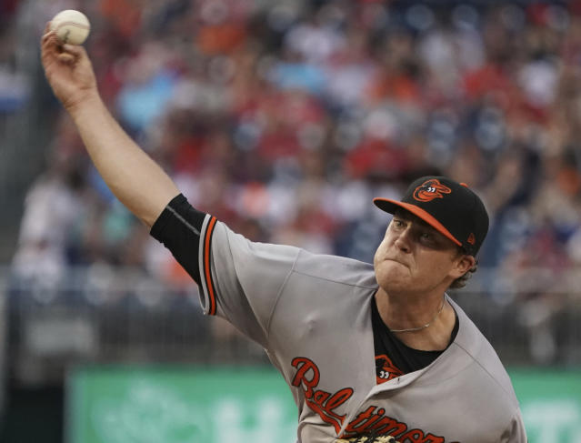 Baltimore Orioles starting pitcher David Hess throws during the third inning of the team's baseball game against the Washington Nationals at Nationals Park, Tuesday, June 19, 2018, in Washington. (AP Photo/Carolyn Kaster)