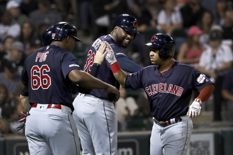 Cleveland Indians Jose Ramirez, right, celebrates with Yasiel Puig (66) and Franmil Reyes after Ramirez's three-run home run off Chicago White Sox's Hector Santiago during the third inning of a baseball game Tuesday, Sept. 24, 2019, in Chicago. (AP Photo/Charles Rex Arbogast)