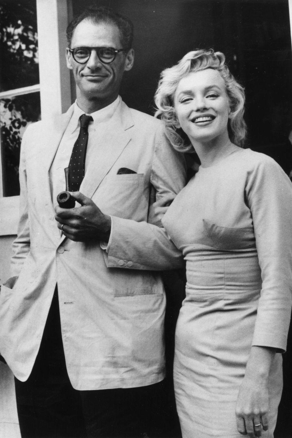 <p>Monroe posing with her second husband, playwright Arthur Miller, in their first year of marriage. At 41 years old he was 11 years her senior. </p>