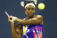 Sloane Stephens, of the United States, returns a shot to Mihaela Buzarnescu, of Romania, during the first round of the U.S. Open tennis championships, Tuesday, Sept. 1, 2020, in New York.(AP Photo/Frank Franklin II)