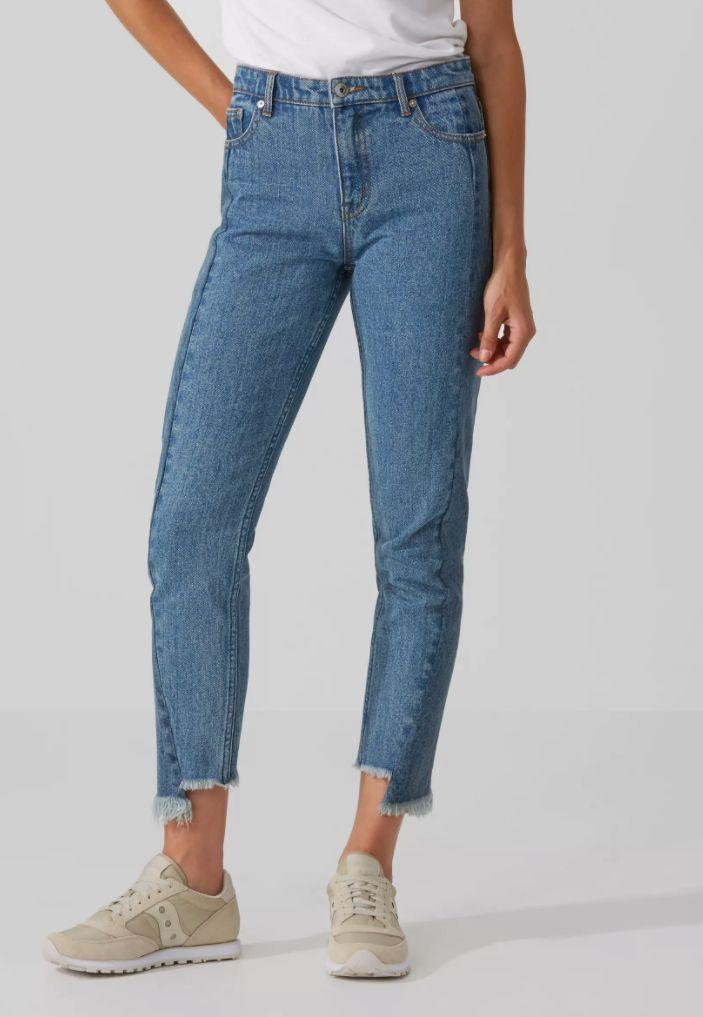"The raw-edge design of these jeans gives them a vintage look, while the high-waisted design gives them a flattering wear. (P.S. <a href=""https://www.frankandoak.com/product/69-2210056-4CW/the-stevie-high-waisted-raw-edge-jean-in-contrast-indigo"" target=""_blank"">They're $50 off now</a>, too)."