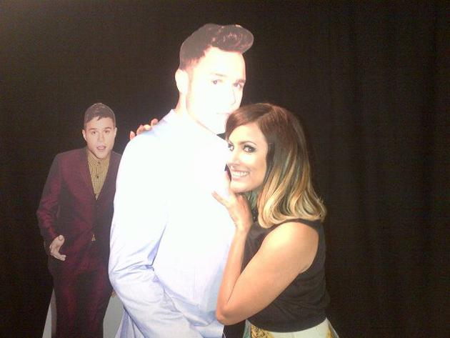 "Celebrity photos: Caroline Flack and Olly Murs were confirmed this week as The Xtra Factor hosts for the upcoming series. Filming has started, but Caroline is alone until the live shows whilst Olly Murs tours America with One Direction. However, she found a cardboard cut-out of Olly and tweeted a photo of her with it, along with the caption: ""Olly is still here!!!!!"" [sic]"