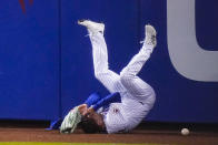 New York Mets' Albert Almora Jr. loses control of the ball hit by Baltimore Orioles' Austin Hays for a triple during the eighth inning of a baseball game Tuesday, May 11, 2021, in New York. (AP Photo/Frank Franklin II)