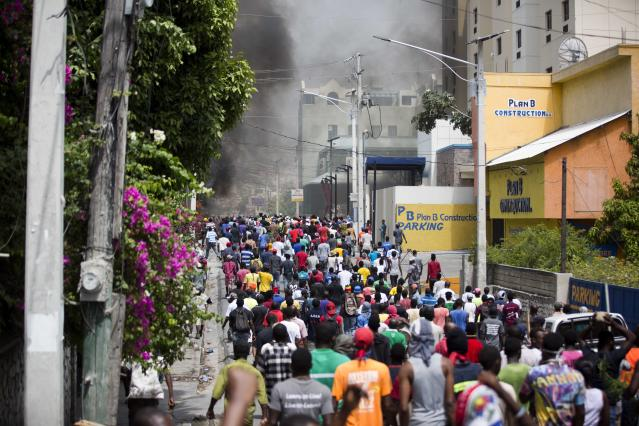 <p>People walk in the street during protests over the fuel price increase in Port-au-Prince, Haiti, on Saturday, July 7, 2018. (Photo: Dieu Nalio Chery/AP) </p>