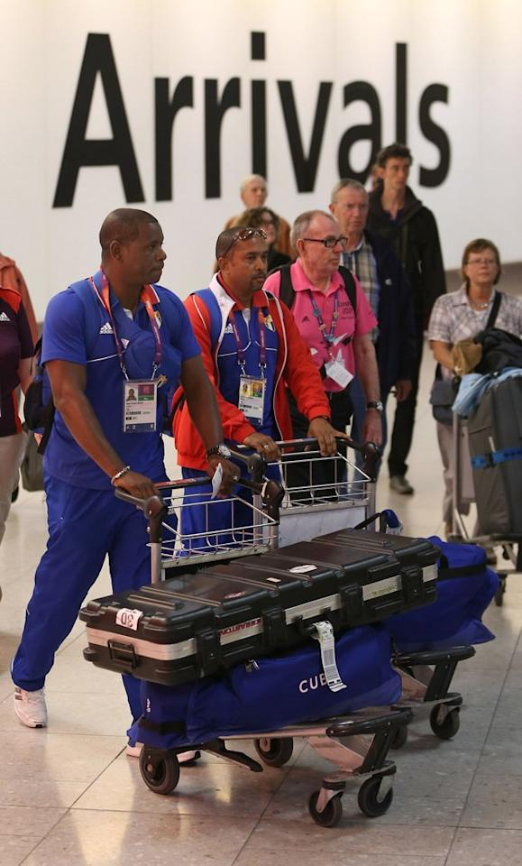 LONDON, ENGLAND - JULY 16: Members of the Cuban Olympic team arrive at Heathrow Airport on July 16, 2012 in London, England. Athletes, coaches and Olympic officials are beginning to arrive in London ahead of the Olympics.