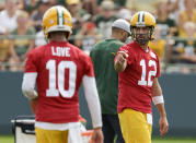 Green Bay Packers' quarterback Aaron Rodgers gestures during NFL football training camp Wednesday, July 28, 2021, in Green Bay, Wis. (AP Photo/Matt Ludtke)