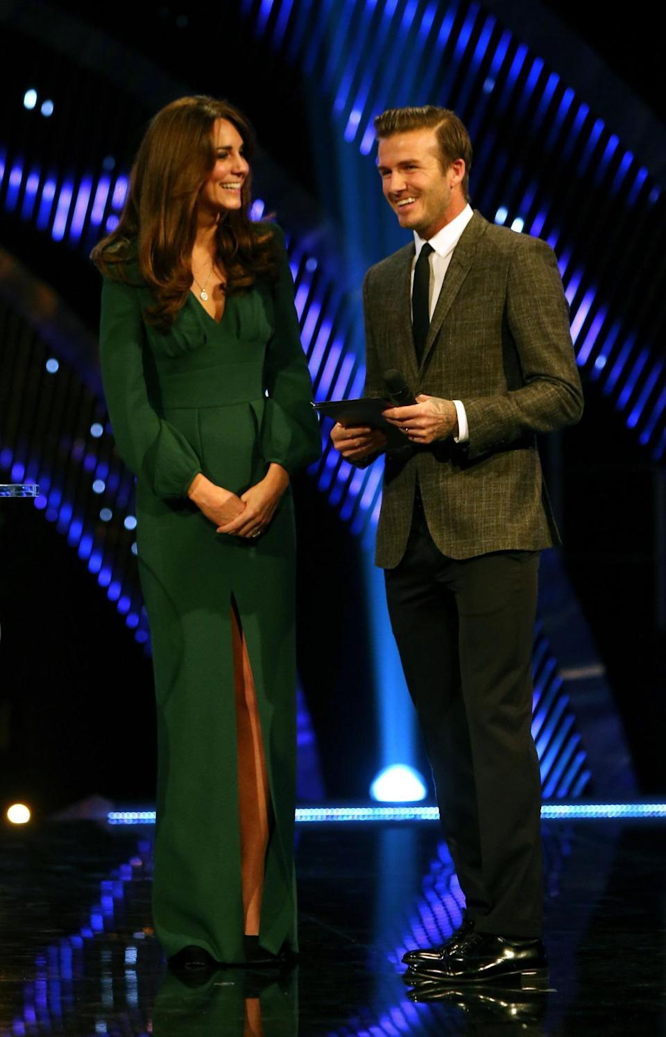 <p>Kate presented an award at the Sports Personality of the Year ceremony wearing a bottle green Alexander McQueen gown. Suede Jimmy Choo pumps completed the look.</p><p><i>[Photo: PA]</i></p>
