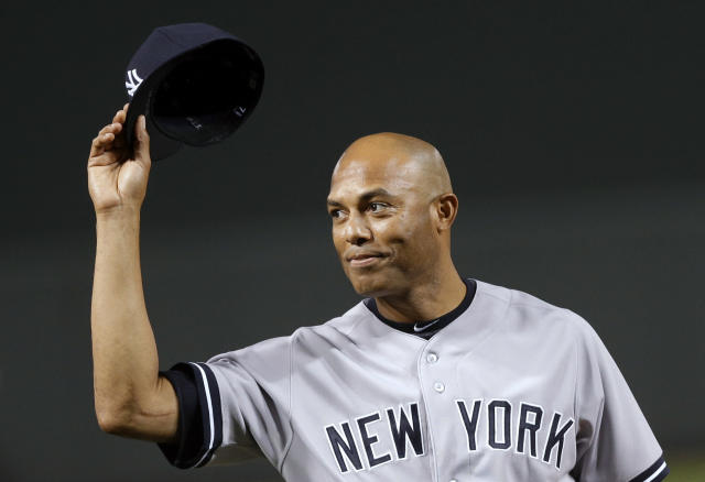New York Yankees relief pitcher Mariano Rivera acknowledges fans during a ceremony held by the Baltimore Orioles to honor his pitching career, before a baseball game between the Yankees and the Orioles, Thursday, Sept. 12, 2013, in Baltimore. (AP Photo/Patrick Semansky)