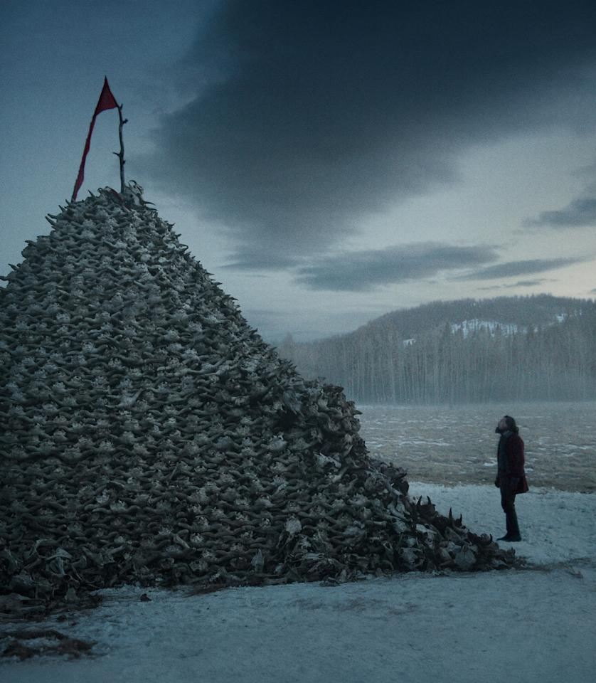"<p>Part of a dream sequence, this scene depicts Glass (DiCaprio) observing a pile of roughly 10,000 buffalo skulls. Iñárritu was more concerned with Glass's inner thoughts and added scenes that aren't in the original book. ""He didn't worry about religiously doing the story,"" says Fisk of the director. </p>"