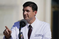 Dr. Sean Conley, physician to President Donald Trump, talks with reporters at Walter Reed National Military Medical Center, Monday, Oct. 5, 2020, in Bethesda, Md. (AP Photo/Evan Vucci)