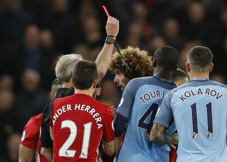 Britain Soccer Football - Manchester City v Manchester United - Premier League - Etihad Stadium - 27/4/17 Manchester United's Marouane Fellaini is shown a red card by referee Martin Atkinson Reuters / Darren Staples
