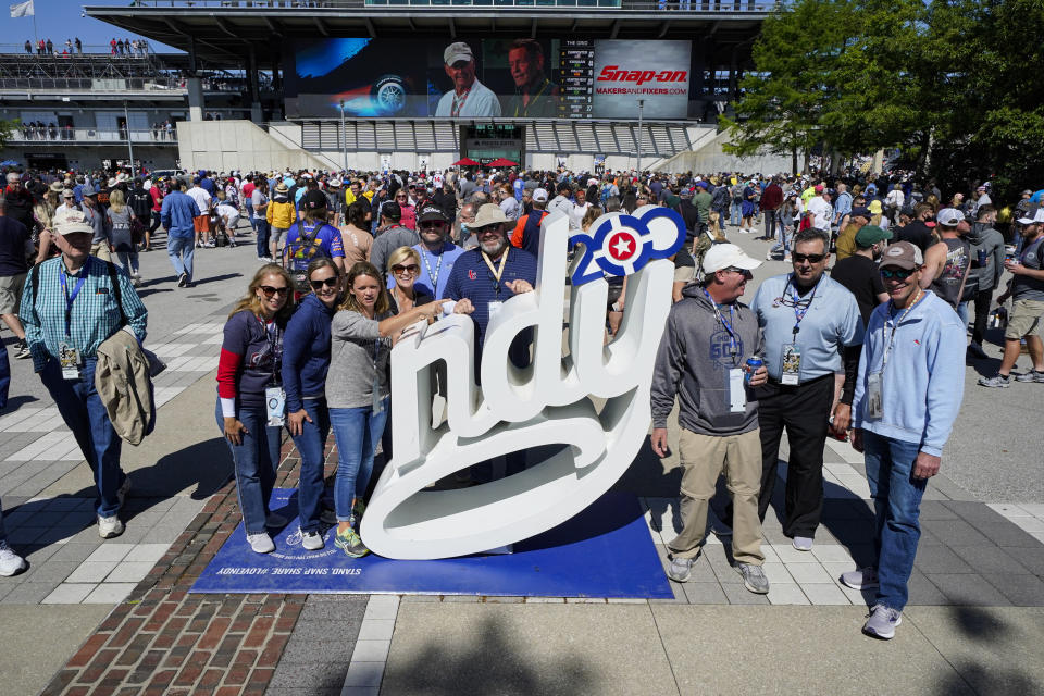 Fans gather for a photo before the start of the Indianapolis 500 auto race at Indianapolis Motor Speedway in Indianapolis, Sunday, May 30, 2021. (AP Photo/Darron Cummings)