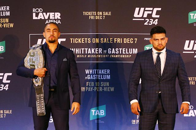 UFC middleweight champion Robert Whittaker (L) poses with Kelvin Gastelum during a UFC press conference at Melbourne Arena on Dec. 3, 2018 in Melbourne, Australia. (Michael Dodge/Zuffa LLC/Zuffa LLC)